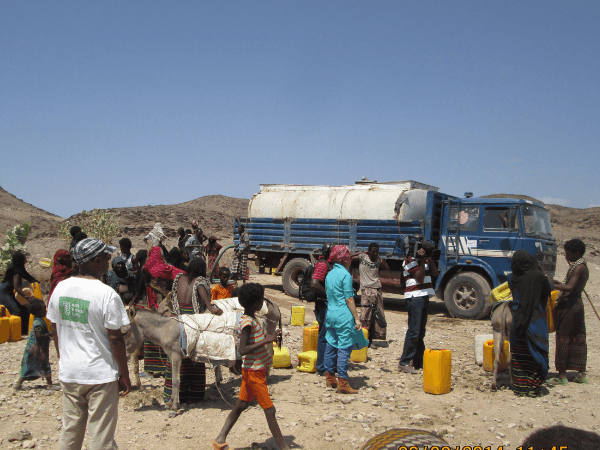 Local aid workers APDA trucking emergency water and food