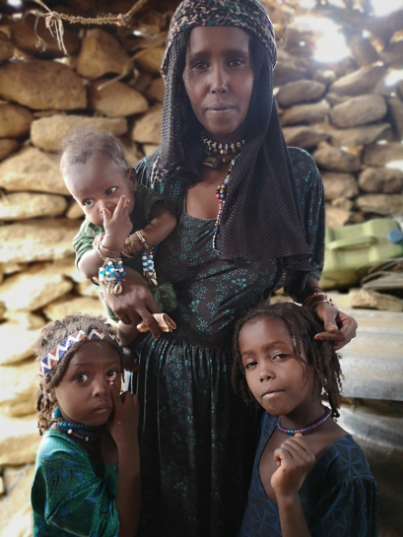 Mother with her children in Afar traditional house