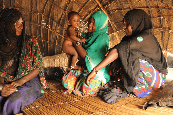 Hasna speaking with other mothers in her village about the dangers of FGM