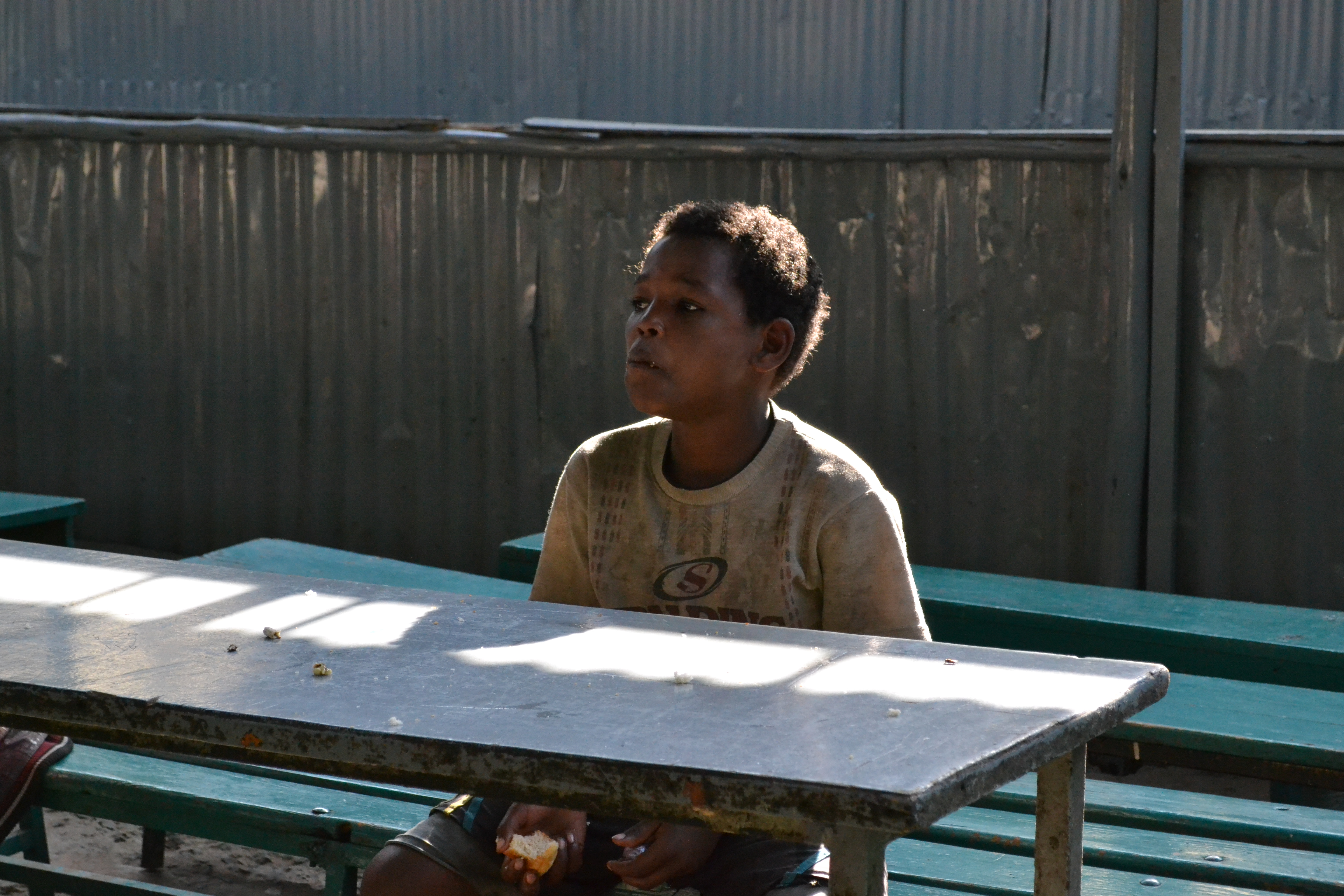 Young Ethiopian boy sitting by himself